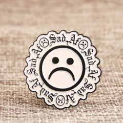 Sad face lapel pins